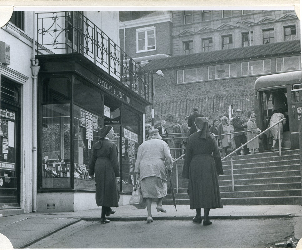 People boarding a bus outside the Post Office in Great Malvern - photograph by Michael Dowty 1971
